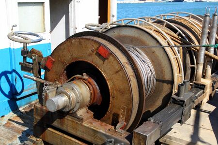 trawler net: capstan winch of trawler fishing boat power engine to pull the net steel cable
