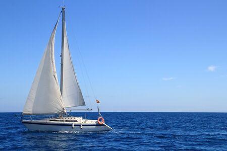 peace risk: beautiful sailboat sailing sail blue Mediterranean sea ocean horizon