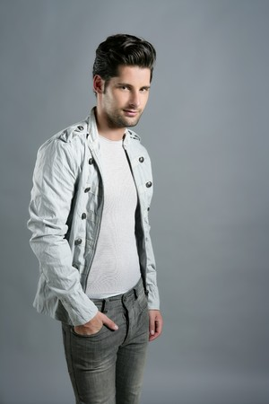 Fashion trendy young man silver  portrait over gray photo