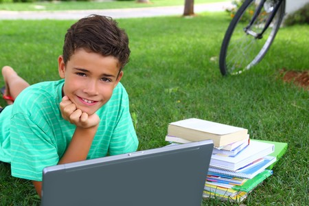 boy teenager homework studying laying green grass garden bycicle background photo
