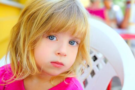 blond little girl portrait looking camera pink dress blue eyes Stock Photo - 7992780