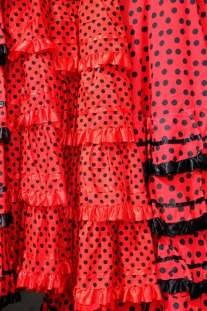 gipsy: Gipsy red spots dress texture background typical from Andalusia Spain Stock Photo