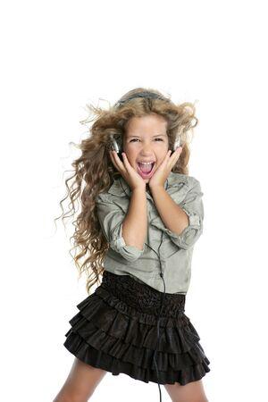dancing little blond girl headphones music singing on white background photo