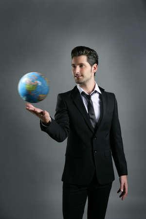 World globe map sphere in businessman hand over dark gray background Stock Photo - 8051181