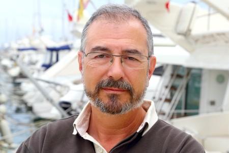 adult cruise: Senior man on marina sport boats portrait happy relaxed