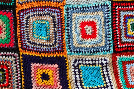 crochet: Crochet patchwork colorful pattern handcraft fabric blanket Stock Photo