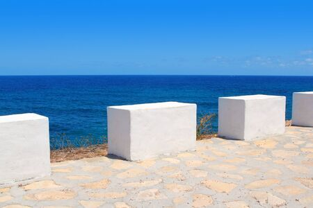 milestones: Mediterranean sea coastal view white milestones in Spain Stock Photo