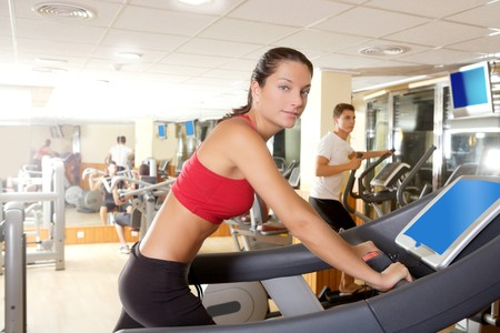 Gym treadmill running young woman inter monitor screen Stock Photo - 8239493