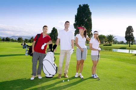 Golf course people group young players team grass field Stock Photo - 8121810