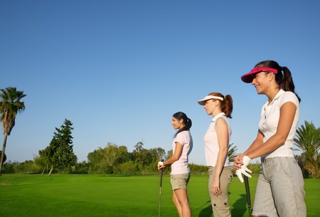 Golf three woman in a row green grass course players photo