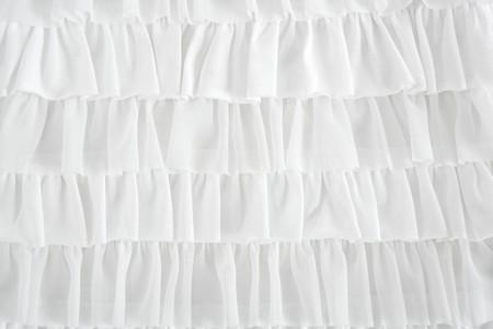 pleated skirt fabric fashion in white closeup detail macro photo