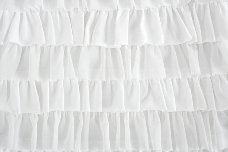 pleated skirt fabric fashion in white closeup detail macro photo