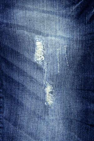 trouser: denim fashion blue jeans trendy broken fabric texture Stock Photo