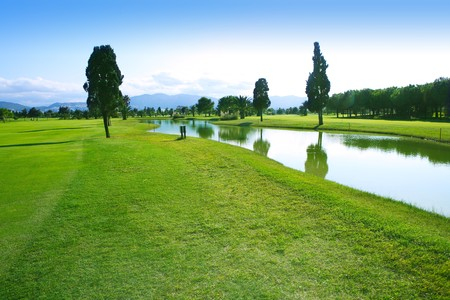 Golf course green grass field lake trees reflection