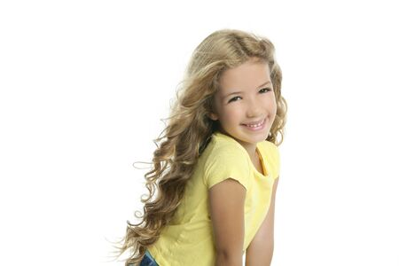 little model: little blond girl smiling portrait yellow tshirt isolated on white background