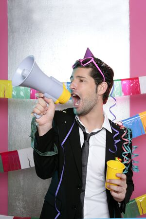 party streamers: Loudspeaker crazy party man shouting happy holiday Stock Photo