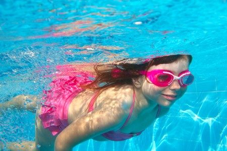 underwater little girl pink bikini goggles blue swimming pool photo