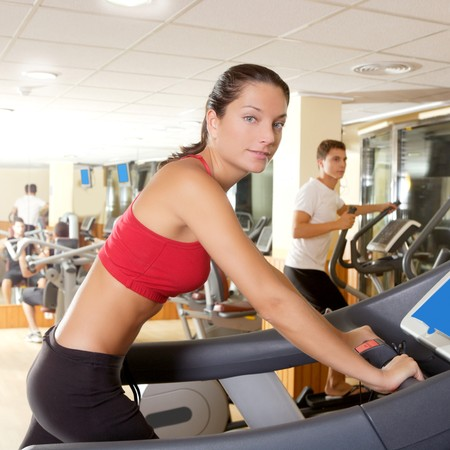 Gym treadmill running young woman interior monitor screen photo