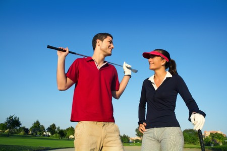 brat: Golf course young happy players couple talking posing on bunker Stock Photo