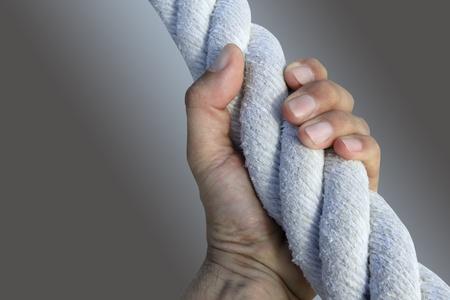 man hand grab grip holding strong big aged marine huge rope photo