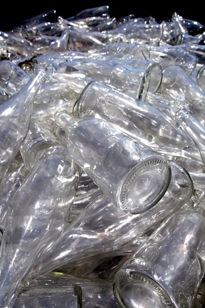 recycle glass: ecological recycling glass bottles in messy container