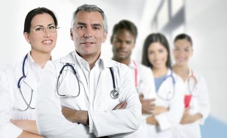 expertise gray hair doctor multiracial nurse team row over white photo