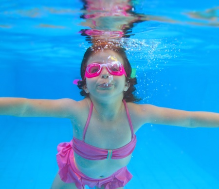 underwater little girl pink bikini goggles blue swimming pool Stock Photo - 8288852