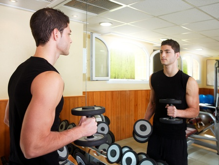Gym young man posing body building weigths black Stock Photo - 8288877