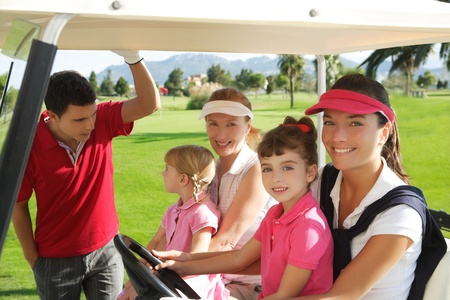 woman golf: golf course mothers and daughters in buggy talking father Stock Photo