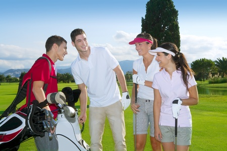golf man: Golf course people group young players team grass field Stock Photo