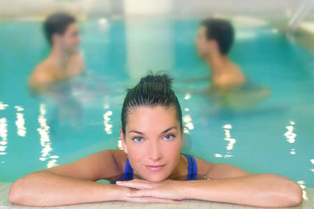 spa woman portrait relaxed in pool water men in background photo