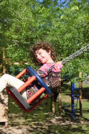 girl swinging on swing happy in trees outdoor up high Stock Photo - 8288977