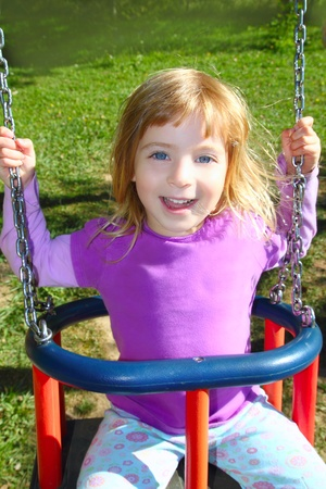 girl swinging on swing happy in meadow grass park outdoor Stock Photo - 8289007