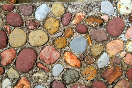 Rolling stones floor colorful pattern in Pyrenees Spain photo