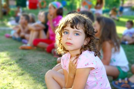 girl spectator little children looking show outdoor park looking camera photo