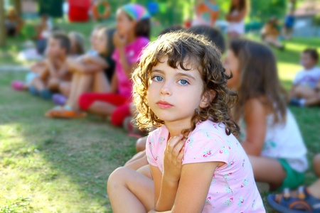 girl spectator little children looking show outdoor park looking camera photo