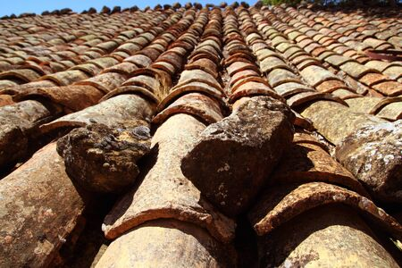 clay roof tiles old aged arabic style in Spain perspective photo