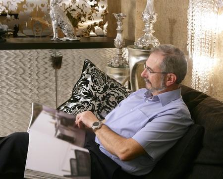 Senion man reading sofa luxury living room black and silver Stock Photo - 8384739