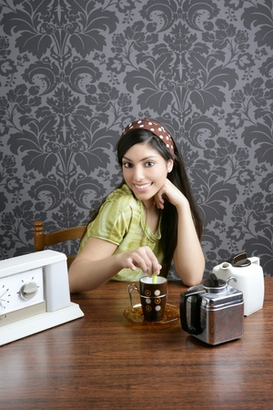 Retro woman drinking coffee on kitchen vintage wallpaper Stock Photo - 8385024