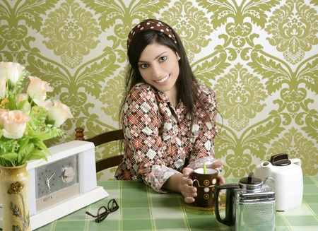 women holding cup: Retro woman drinking coffee on kitchen vintage wallpaper