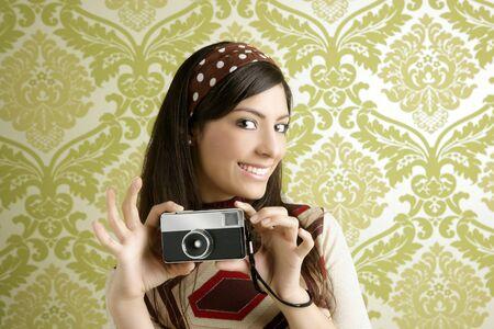 Retro photo camera shooting woman green sixties wallpaper vintage  Stock Photo - 8385017
