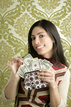 retro purse dollar woman smiling on vintage green wallpaper photo