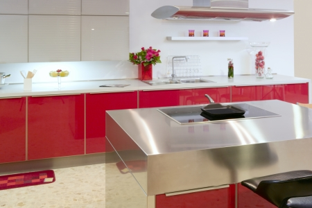 Red island kitchen silver modern interior house architecture Stock Photo - 8384724