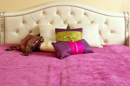 diamond upholstery buttons bed head pink blanket colorful pillows photo