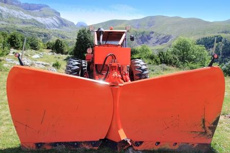snowplow tractor in mountain outdoor in spring season photo
