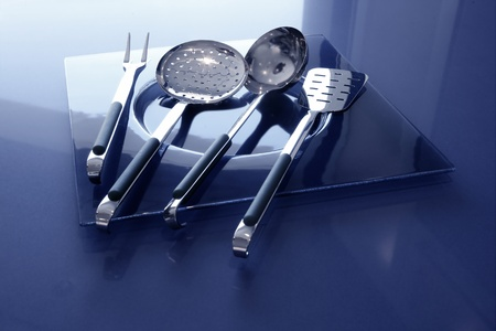 kitchenware kitchen utensils blue table and stainless steel photo