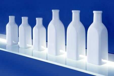 white bottles in row blue background glowing shelf decoration photo