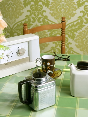 old items: coffee machine retro kitchen tablecloth green wallpaper vintage