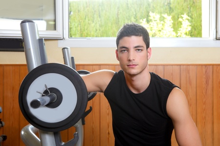 Gym young man posing body building weigths black  photo