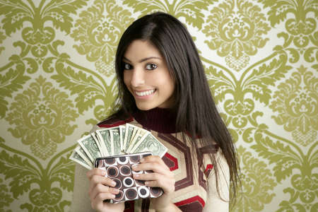indian money: retro purse dollar woman smiling on vintage green wallpaper